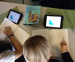 A kid combining digital and analog learning