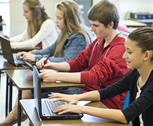 Students using laptops in class