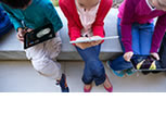 Kids using iPads to learn