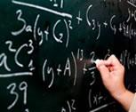 Teacher writing on a board