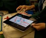 A teacher using an iPad
