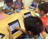 Kids using iPads to learn