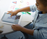 A kid interacting with an iPad