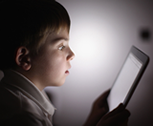 A kid using an iPad to learn