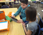 Kids interacting with peers and Nearpod